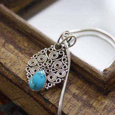 Silver and turquoise stone Indian pendant