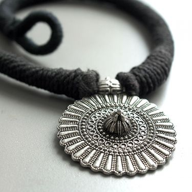 Metal and cotton Indian necklace