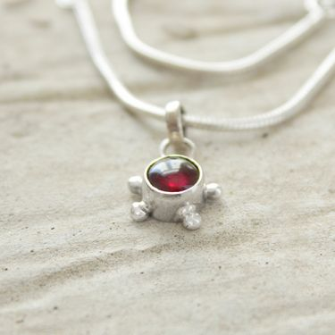 Silver and garnet stone Indian pendant