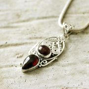 Silver and garnet stones Indian pendant