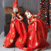 Indian handicraft puppets couple red