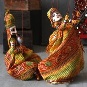 Indian handicraft puppets red and yellow